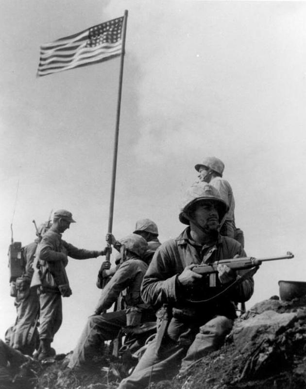 Soldiers raising flag