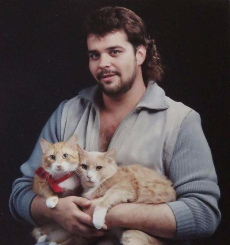 Men Posing With Their Cats 11