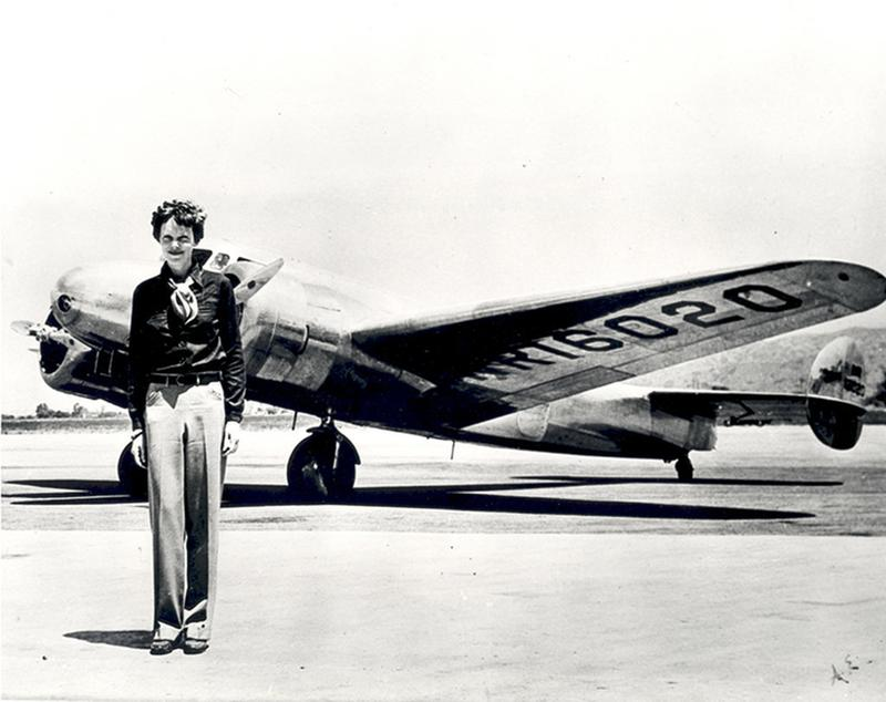 amelia-earhart-standing-in-front-of-the-lockheed-electra-in-which-she-disappeared-in-july-1937