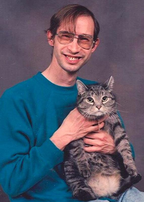Men Posing With Their Cats 10